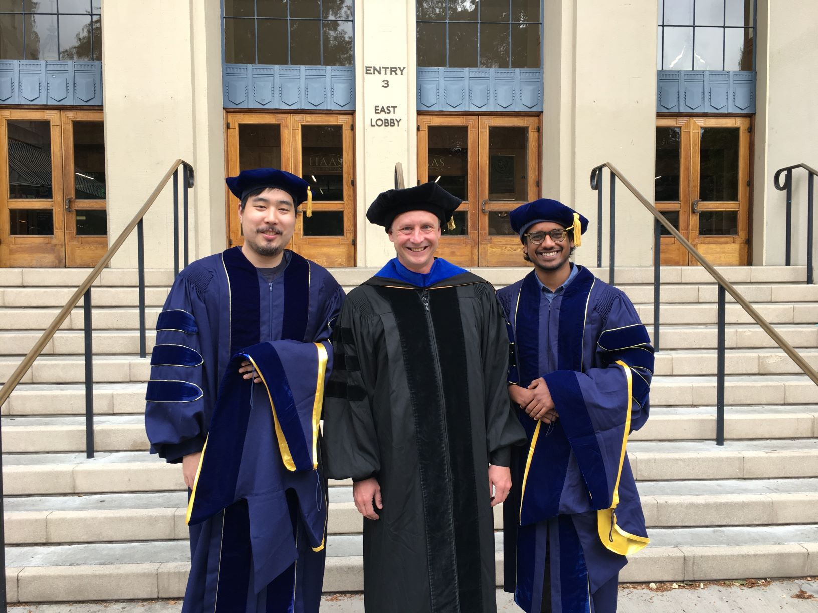 Graduates Jonathan Jui (left) and Shariq Mobin (right) are pictured with PhD Program Director Michael Silver (center).